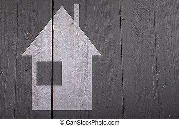 Illustration of white house on dark black wooden background