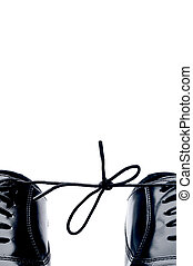 Vertical close up of a pair of black leather business shoes...