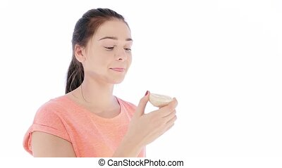 Girl Tries a Slice of Lemon - Lovely young woman making...