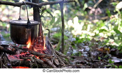 Cooking on a Campfire - Campfire cooking in the Amazon rain...