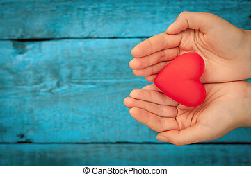 Red heart in the hands - Valentine day. Red heart in the...