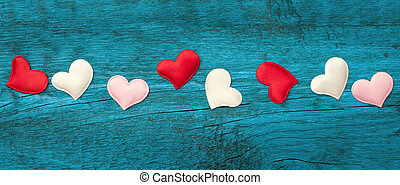 Red hearts on the blue boards - Valentine day. Red hearts on...