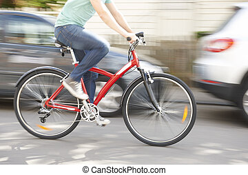 Cyclist At Speed Along Urban Street