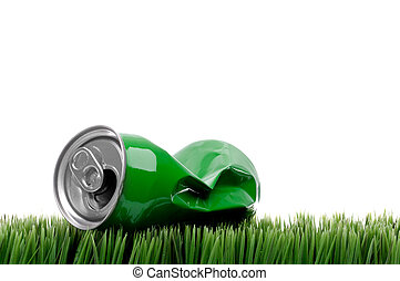 horizontal close up of a green crushed aluminum drink can on grass
