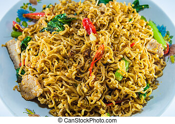 fried noodles on white background