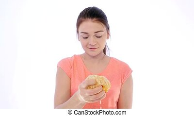 Girl Squeezing Orange Juice - Young Woman Squeezing Orange...