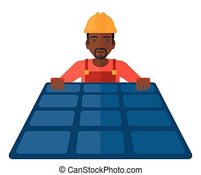 Constructor with solar panel - An african-american...