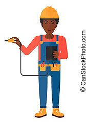 Electrician with electrical equipment - An electrician in...
