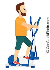 Man making exercises - A man exercising on a elliptical...