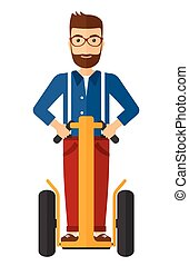 Man riding on segway. - A hipster man with the beard riding...