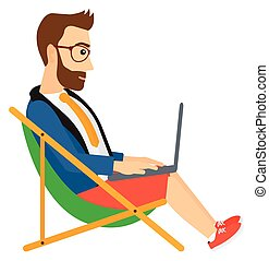 Businessman sitting in chaise lounge with laptop.