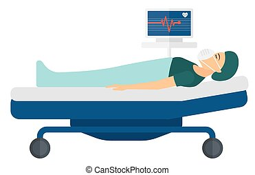 Patient lying in bed with heart monitor - A patient in mask...