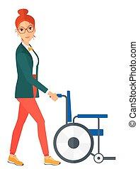 Woman pushing wheelchair - A woman pushing empty wheelchair...