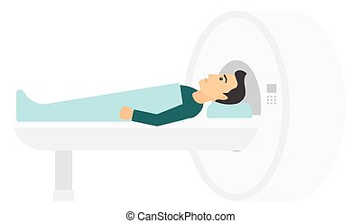 Magnetic resonance imaging - A man undergoes an magnetic...