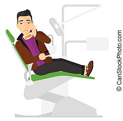 Man suffering in dental chair. - A patient sitting in dental...