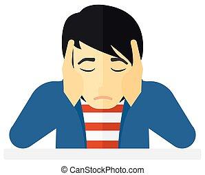 Anxious man clutching his head. - Anxious man clutching his...