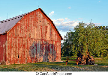 red barn with tree shadow