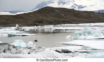 Blue icebergs floating on Jokunsarlon glacial lagoon