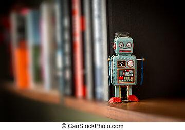 Vintage tin toy robot on a book shelf - Retro tin toy robot...