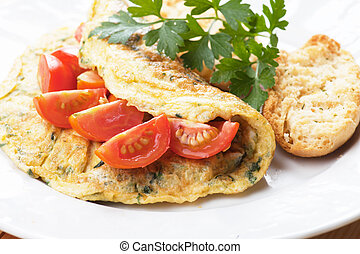 Omelet with cherry tomato
