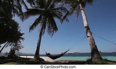 Hammock on beautiful beach.