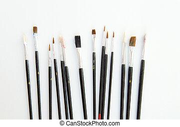 Illustrator paintbrushes on white background closeup