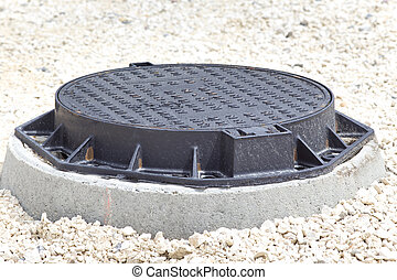 Manhole cover - Close up of new metal cover over concrete...