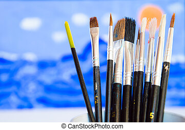 Illustrator paintbrushes on watercolor draw background