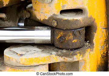 Hydraulic piston on bulldozer - Fragment of dirty hydraulic...