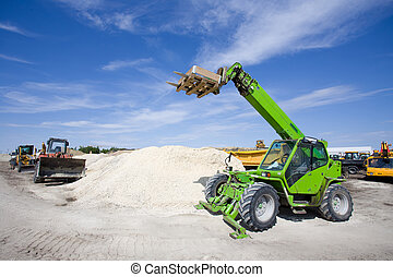 Construction vehicles at building site - Wide angle of...