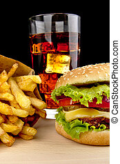 Menu of cheeseburger,french fries,glass of cola on wooden desk on black