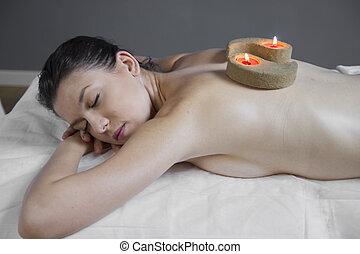 fresh massage, beautiful woman lying on a stretcher...