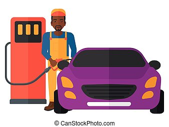 Man filling up fuel into car - An african-american man...