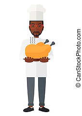 Man holding roasted chicken - A chef holding a plate with a...