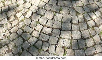Walking along the pavement - Walking along stone pavement