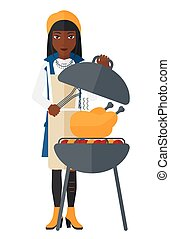 Woman preparing barbecue. - A woman cooking chicken on...