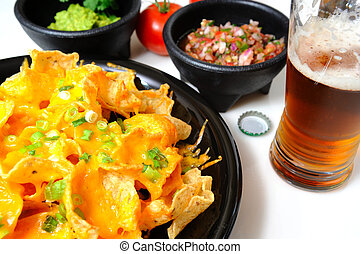 Nachos and Beer - Cheese nachos with sides of guacamole and...