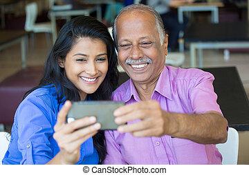 Family selfie - Closeup portrait happy elderly gentleman in...