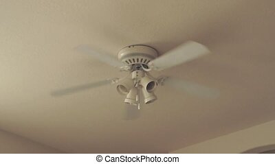 white ceiling fan - A five bladed ceiling fan with lights is...