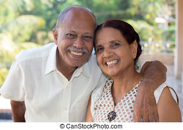 Happy old couple - Closeup portrait, retired couple in white...
