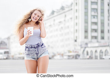 Fun and dances. - Happy young woman with music headphones,...