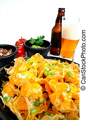 Nacho and Beer - Plate of cheese nachos with sides of...