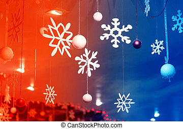 Beautiful white snowflakes on a colorful background,...