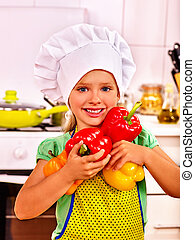 Child cooking at kitchen - Child wearing cooking hat holding...