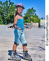 Girl riding on roller skates. - Girl riding on roller skates...