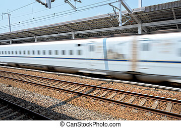 Fast bullet train passes at a high speed - Bullet train in...