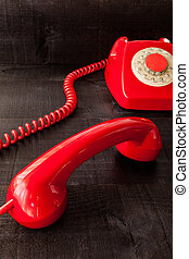The red retro telephone - The image represents a vintage red...
