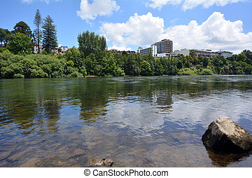 Waikato River passing through Hamilton, New Zealand -...