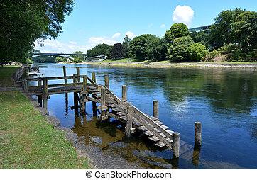 Waikato River passing through Hamilton, New Zealand -...