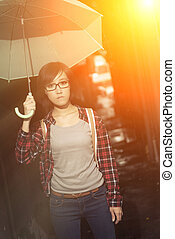 blue woman - Young girl hold umbrella and stand at narrow...